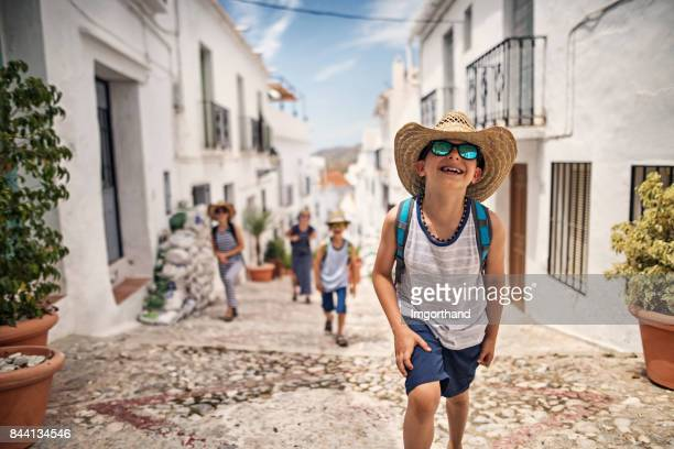 LIttle boy with family visiting andalusian white village