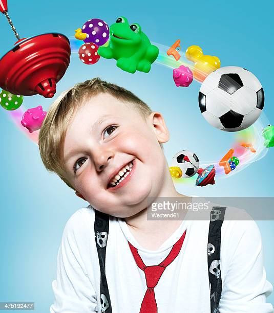 Little boy with flying toys around his head, Composite