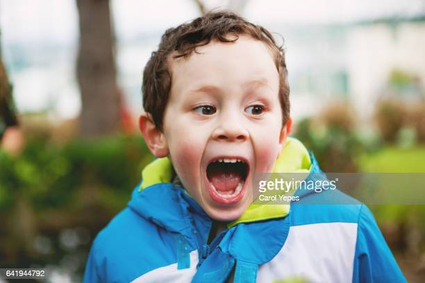 little boy with funny face - kid middle finger stock pictures, royalty-free photos & images