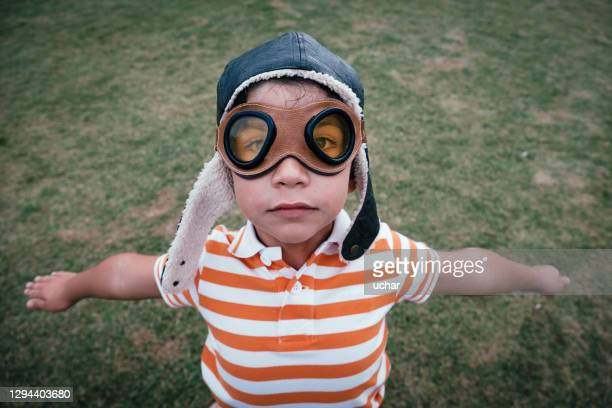 little boy with goggles images flying - aviation hat stock pictures, royalty-free photos & images