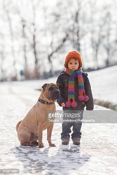 Little boy with his big dog friend