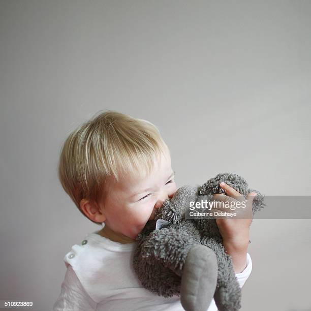 A little boy with his cuddly toy