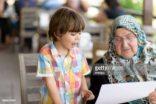 little boy with his grandmother - iranian culture stock pictures, royalty-free photos & images