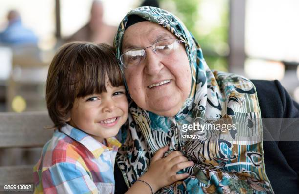 little boy with his grandmother - iranian woman stock photos and pictures