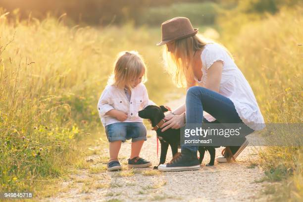 Little boy with his mother and puppy