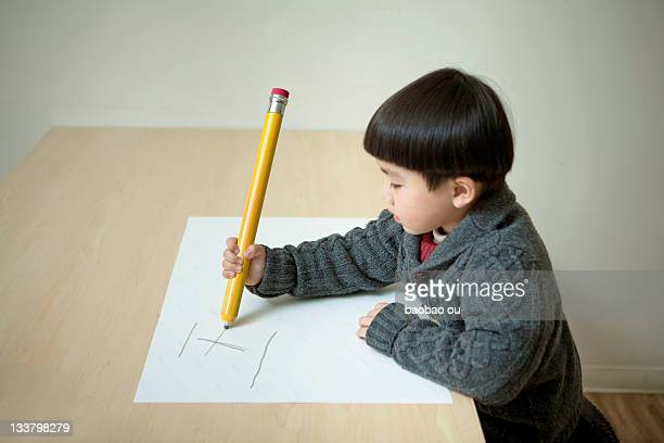Little boy with huge pencil