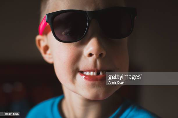 little boy with missing tooth - tooth fairy stock pictures, royalty-free photos & images