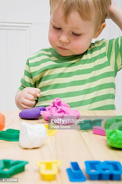 Little boy with modelling clay