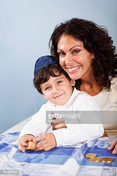 Little boy with mother celebrating Hanukkah