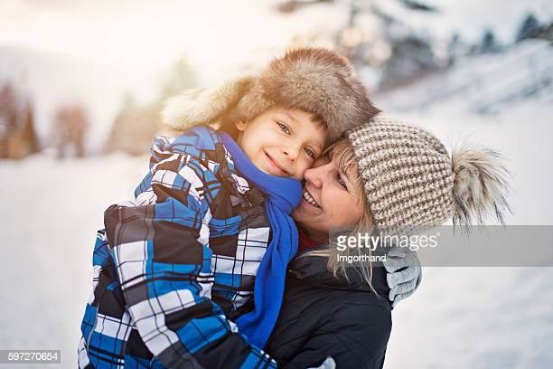 Little boy with mother on winter walk