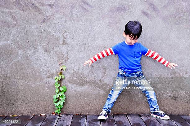 little boy with open arms to play the game. - legs spread open stock photos and pictures