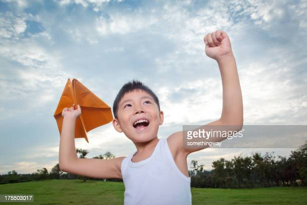 Little Boy with Paper Airplane