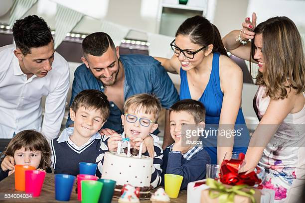 Little boy with parents birthday party