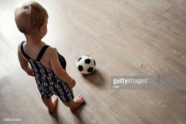 little boy with soccer ball - football bulge stock pictures, royalty-free photos & images