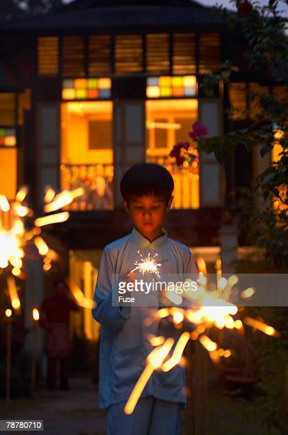 little boy with sparklers - hari raya stock pictures, royalty-free photos & images