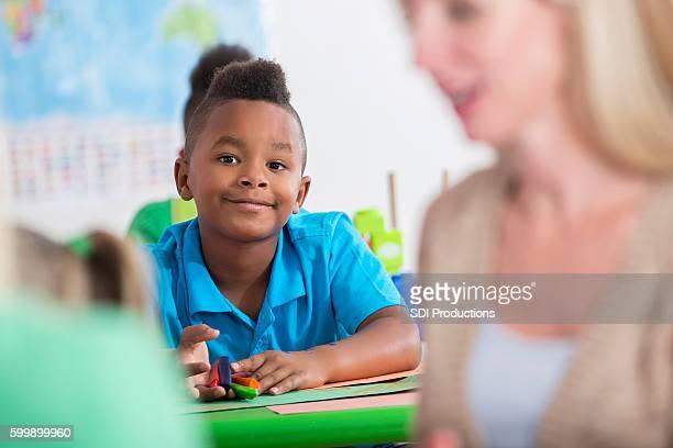 Little boy works on project in his kindergarten class