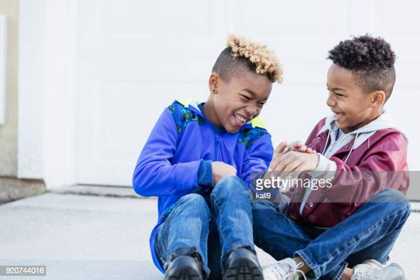 Little boys, brothers and best friends, laughing