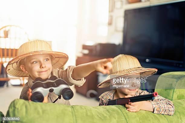 Little boys explorers adeventuring in living room
