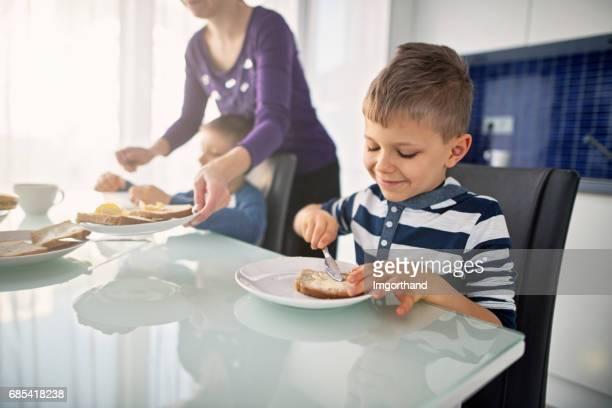 Little boys having breakfast