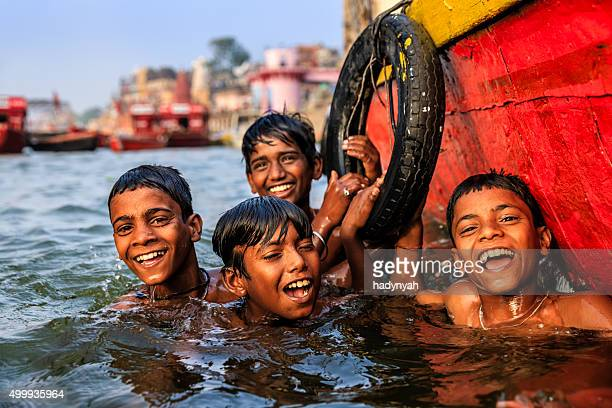Little boys having fun in  Ganges River, Varanasi