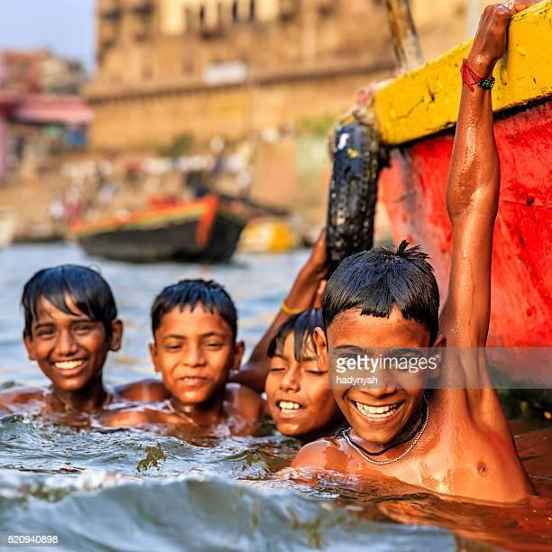 Little boys having fun in  Ganges River, Varanasi
