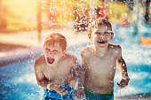 Little boys having fun in waterpark