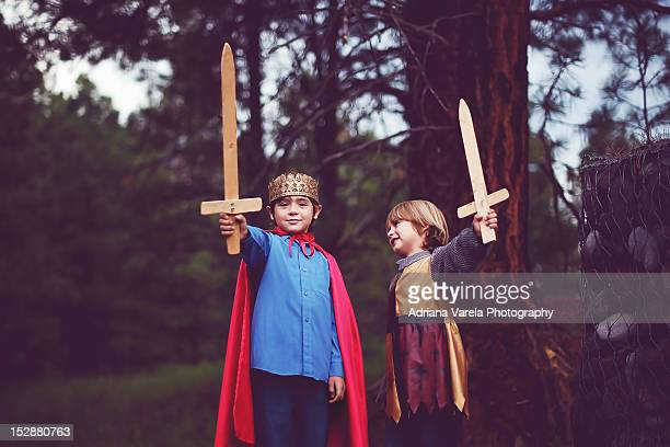 Little boys in king costumes
