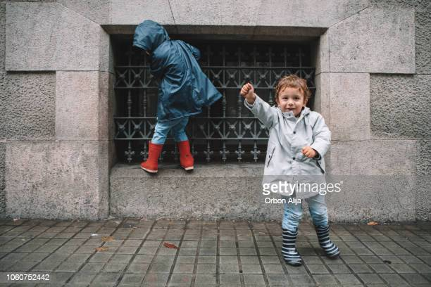 little boys in rain - jacket stock pictures, royalty-free photos & images