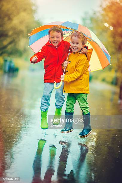 Little boys in rain