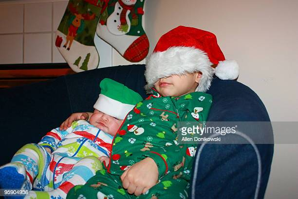 little boys in santa hats - filipino christmas family stock pictures, royalty-free photos & images