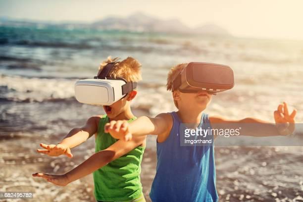 Little boys on virtual reality beach