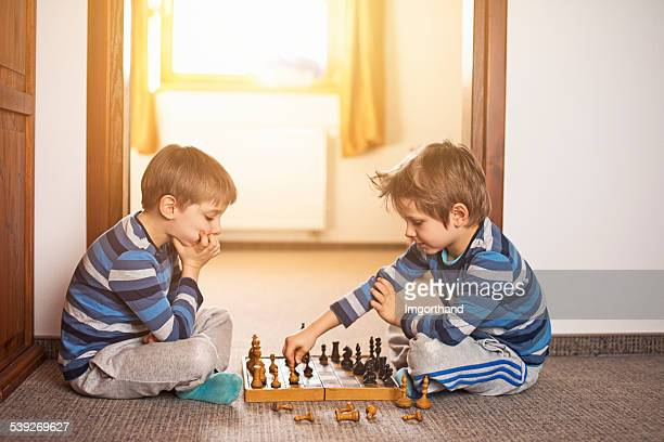 Little boys playing chess together