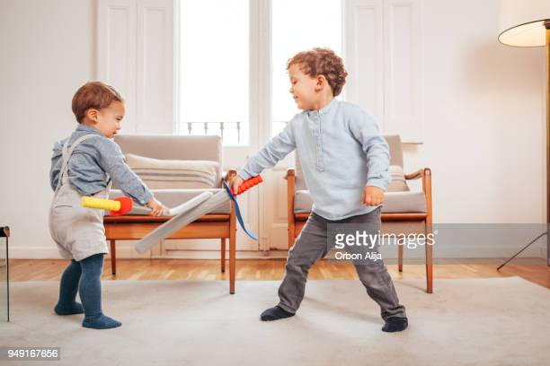 little boys playing knights at home - sword stock pictures, royalty-free photos & images