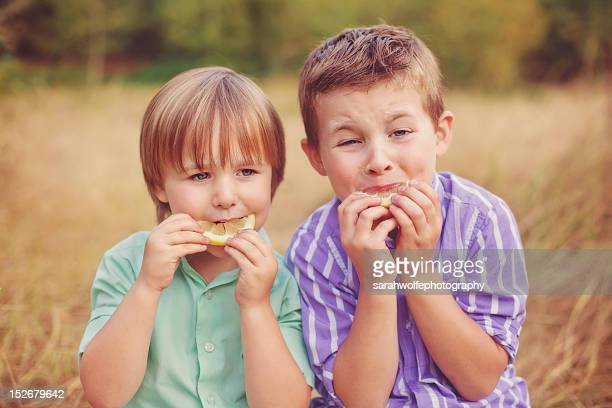 little boys puckering over sour lemons - male stripper stock pictures, royalty-free photos & images