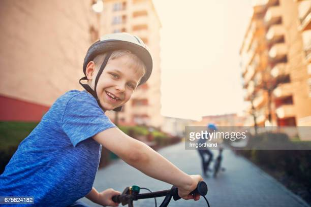 Little boys riding bicycles in residential area