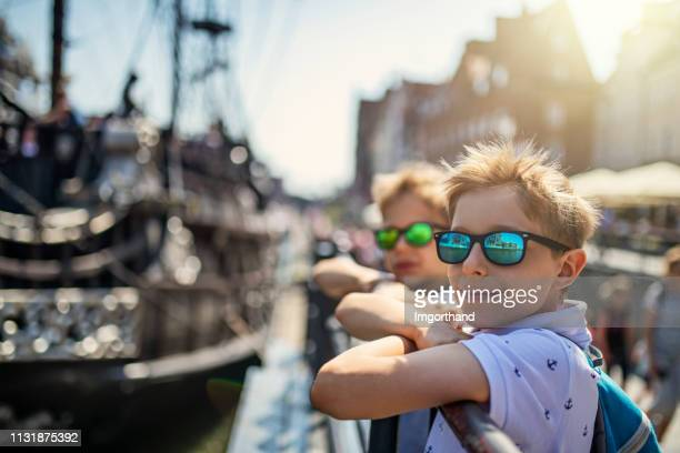 little boys sightseeing harbor of gdansk, poland - gdansk stock pictures, royalty-free photos & images