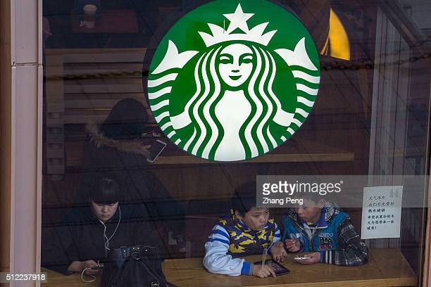 Little boys sit in a Starbucks coffee house after school Starbucks already has nearly 2000 stores in mainland China and plans to have 3400 by 2019...