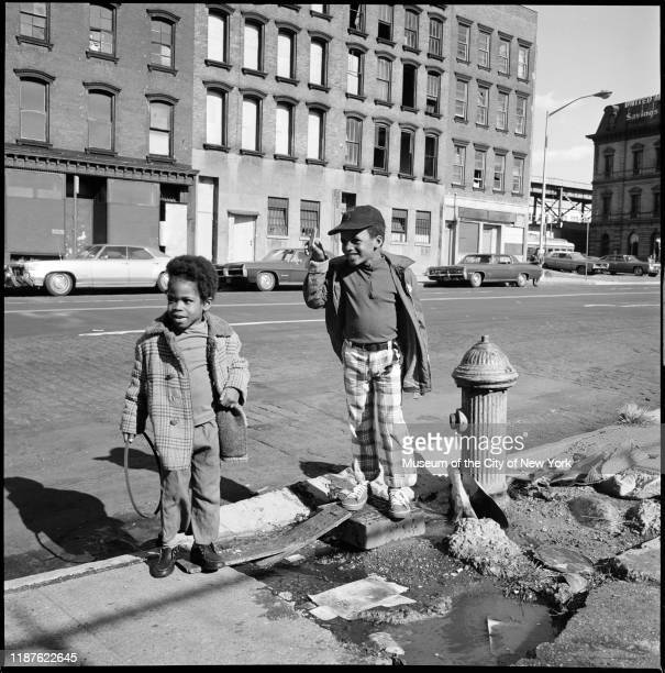 Little boys stand on the south side of Broadway between Berry Street and Bedford Avenue Brooklyn New York New York circa 1975