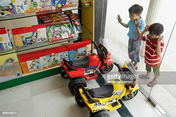 Little boys staring in toy store window