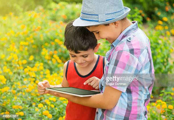 Little boys using digital tablet