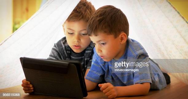 Little boys using digital tablet.