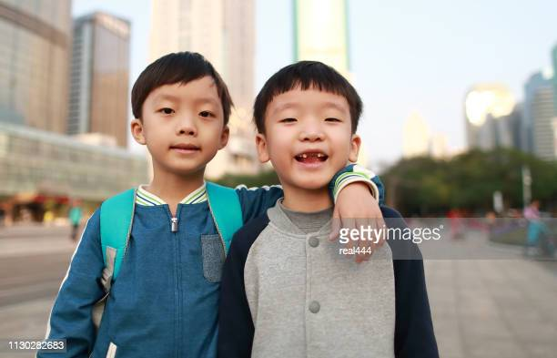little boys walk to school - guangdong province stock photos and pictures