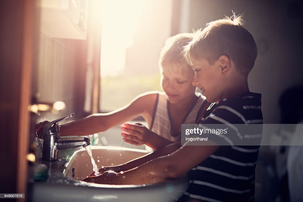 Little boys washing hands : Stock Photo