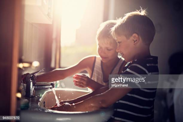 little boys washing hands - handwashing stock pictures, royalty-free photos & images