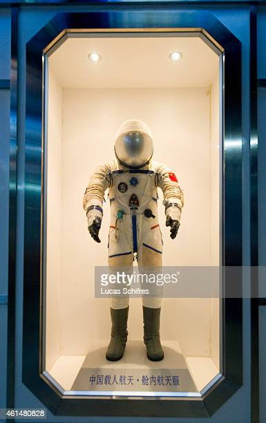 Little boys watch the space suit of a Chinese astronaut in Shanghai's Science and Technology Museum on August 5 2010 in Shanghai China