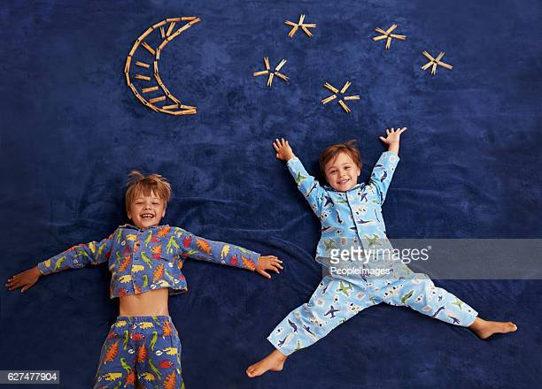 little boys with big dreams - mini moon stock pictures, royalty-free photos & images