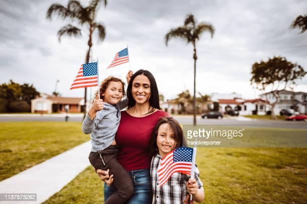 little boys with family celebrate the fourth of july - independence day stock pictures, royalty-free photos & images