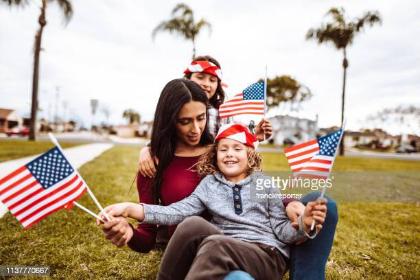 little boys with family celebrate the fourth of july - parade stock pictures, royalty-free photos & images