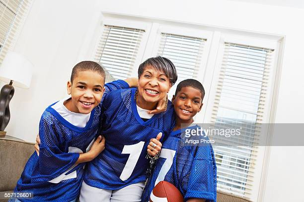 Little Boys with Their Grandmother Dressed in Football Jerseys