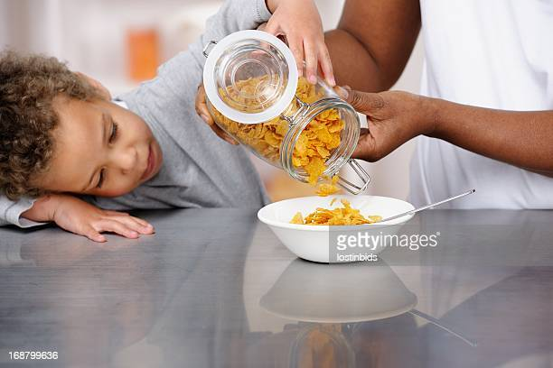 Little Boy/Toddler Concentrating On Helping Carer Prepare Brekfast